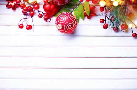 vintage background: Christmas and New Year decoration over white wooden background. Border art design with holiday baubles Stock Photo