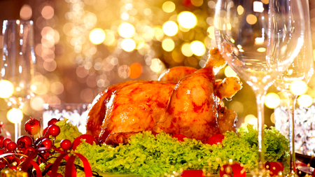 traditional: Holiday decorated table, Christmas tree, champagne and roasted turkey