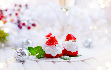 christmas decorations: Christmas strawberry Santa. Funny dessert stuffed with whipped cream. Xmas party food idea Stock Photo