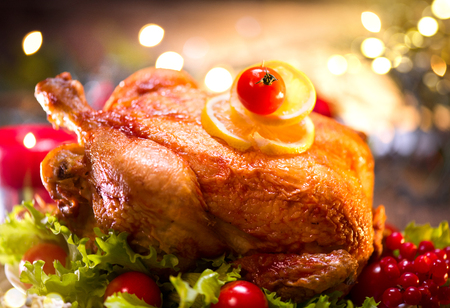 traditional: Christmas holiday decorated table with turkey. Christmas family dinner