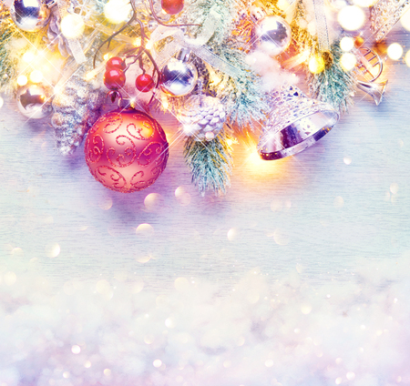 berry: Christmas and New Year decoration over white wood background. Border art design with holiday baubles