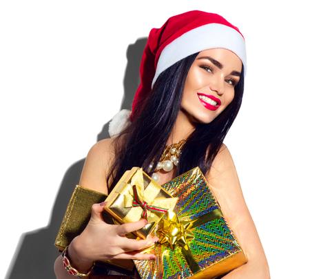 Christmas fashion model girl. Sexy Santa holding gifts Standard-Bild