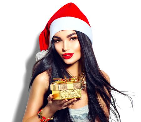 christmas gift: Beauty Christmas fashion model girl holding golden gift box