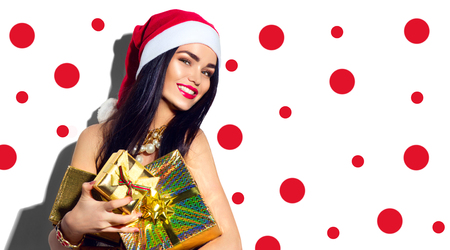 box: Christmas fashion model girl. Sexy Santa holding gifts Stock Photo