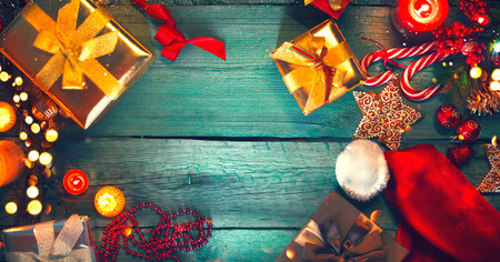 christmas gift: Christmas. Santas gifts on green wooden table. Xmas holiday vintage background Stock Photo