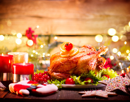 christmas decorations: Christmas holiday family dinner. Decorated table with roasted turkey