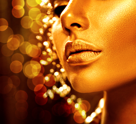 Beauty model girl with golden skin. Fashion art portrait Stok Fotoğraf