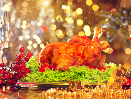 christmas decorations: Holiday decorated table, Christmas tree, champagne and roasted turkey
