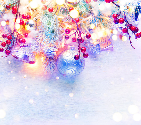 tinsel: Christmas and New Year decoration over white wood background. Border art design with holiday baubles