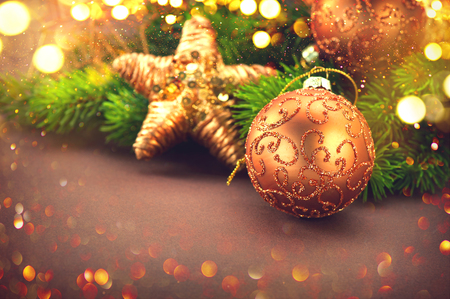 golden: Christmas and New Year Decoration over brown background