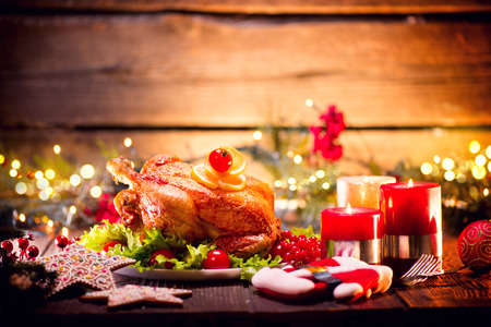 plate: Christmas holiday family dinner. Decorated table with roasted turkey
