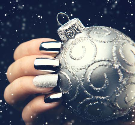 Christmas nail art manicure idea. Winter holiday bright manicure design Stock Photo