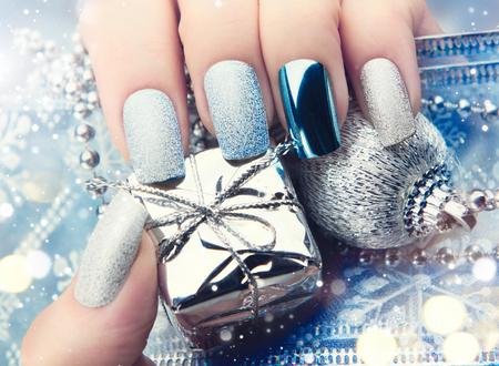 silver: Christmas nail art manicure idea. Winter holiday bright manicure design Stock Photo