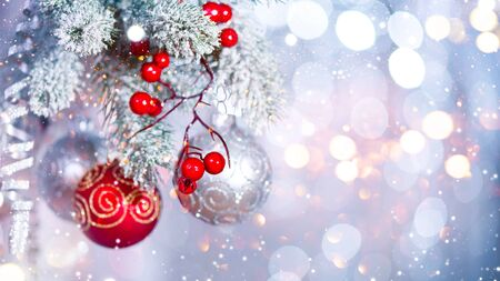 christmas decorations: Christmas holiday abstract silver background. Hanging baubles on Christmas tree Stock Photo