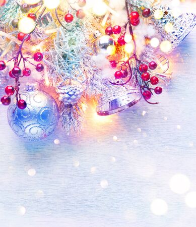 decoration: Christmas and New Year decoration over white wood background. Border art design with holiday baubles