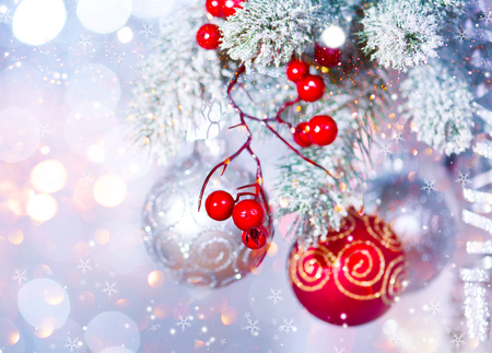 abstract backgrounds: Christmas holiday abstract silver background. Hanging baubles on Christmas tree Stock Photo