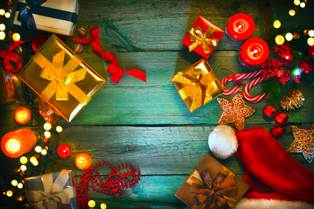 Christmas. Santas gifts on green wooden table. Xmas holiday vintage background Stock Photo