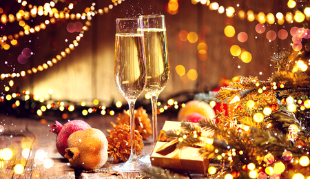 Christmas and celebration with champagne. New Year holiday decorated table