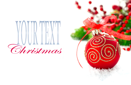 berry: Christmas tree decorated with red baubles. New Year decoration over white background