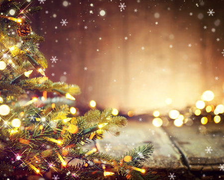 wood floor: Christmas holiday blurred background with Christmas tree and garlands