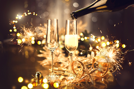 Christmas and celebration with champagne. New Year holiday decorated table Stock Photo