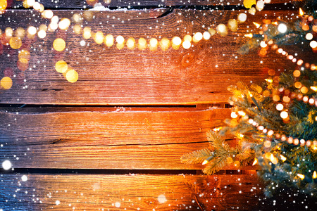 Christmas holiday wooden background with Christmas tree and garlands Stok Fotoğraf