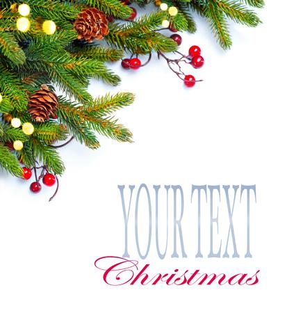 fruit: Christmas corner background. Decorated xmas tree isolated on white Stock Photo