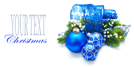 blue border: Christmas and New Year Blue blue decoration isolated on white. Border art design with holiday baubles