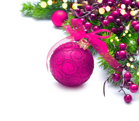 Christmas tree decorated with red baubles. New Year decoration over white background