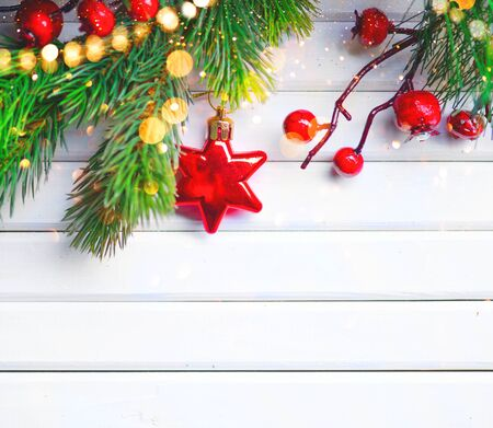 copyspace: Christmas and New Year decoration over white wooden background. Border art design with holiday baubles Stock Photo