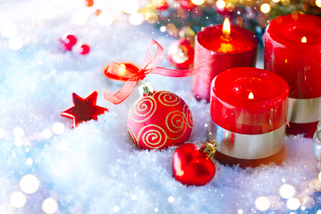 Red Christmas and New Year decorations over white snow background Stock Photo