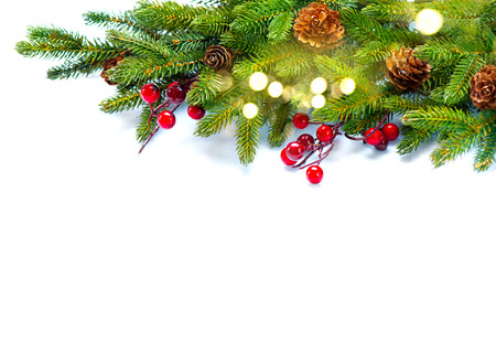 Christmas corner background. Decorated xmas tree isolated on white Stock Photo