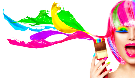 Dyed hair humor concept. Beauty model woman painting her hair in colourful bright colors photo