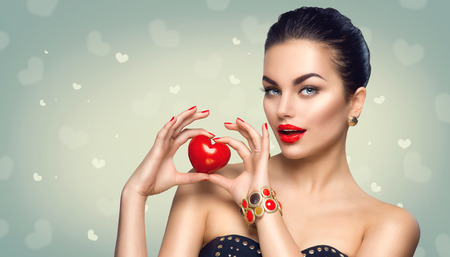 fashion: Fashion woman with red heart. Valentines day art portrait. Beautiful makeup and manicure
