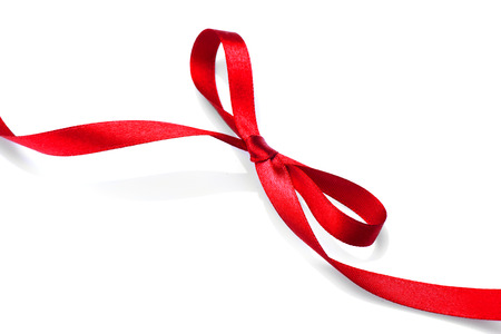 Valentine gift red tape bow. Elegant red satin gift ribbon isolated on white