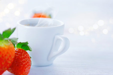 Healthy breakfast. Cup of coffee and strawberries over white background
