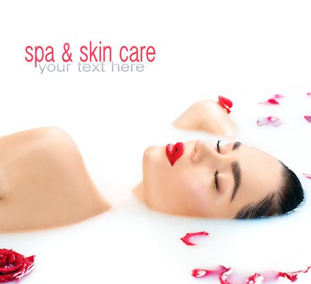 face to face: Beautiful fashion model girl taking milk bath, spa and skincare concept