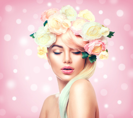 Beauty summer model girl with colorful flowers wreath. Flowers hair style
