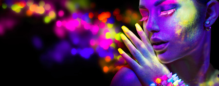Beauty woman in neon light, portrait of beautiful model with fluorescent makeup Фото со стока