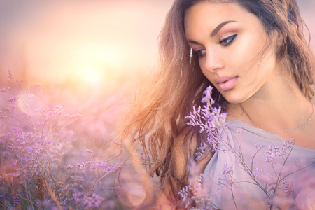 Beauty romantic girl portrait. Beautiful woman enjoying nature over sunset Stock fotó