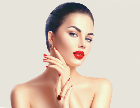 close up: Sexy woman with red lips and nails closeup. Makeup concept