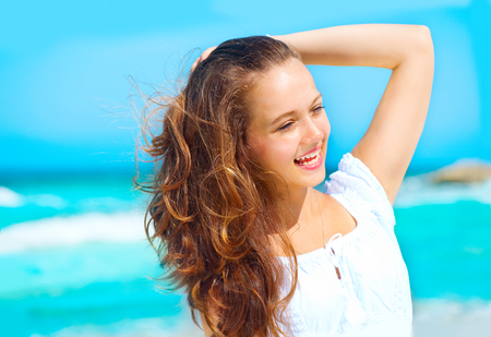 water wave: Beauty young healthy woman enjoying vacation over ocean background. Caribbean holidays Stock Photo
