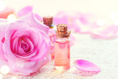 oil lamp: Bottles of essential rose oil for aromatherapy. Rose spa concept