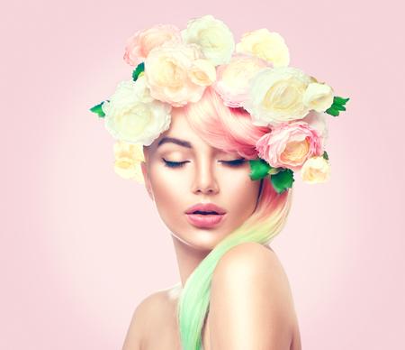 色とりどりの花の花輪を持つ美夏モデル少女。花の髪のスタイル