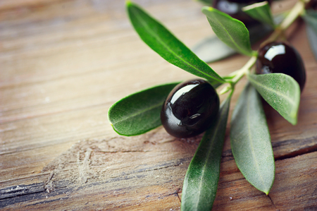 traditional: Olive over wood background. Fresh and healthy organic olives border design