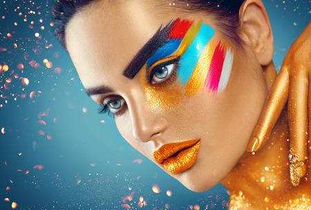 hand colored: Beauty fashion art portrait of beautiful woman with colorful abstract makeup