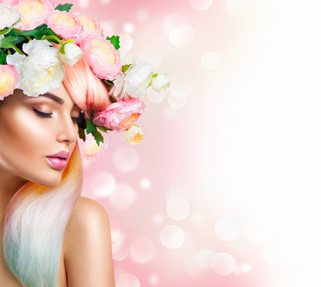 Blooming flowers wreath on womans head. Flowers hairstyle