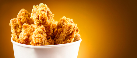 Fried Chicken wings and legs. Bucket full of crispy kentucky fried chicken