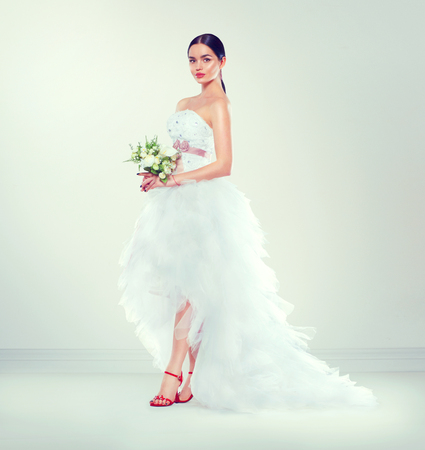 Beauty fashion young model bride in wedding dress with long train