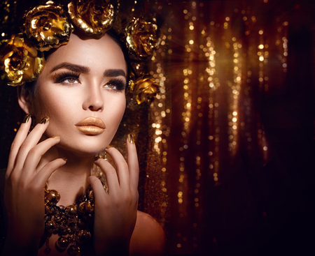 occupation: Golden holiday makeup. Golden wreath and necklace. Fashion art hairstyle, manicure and makeup